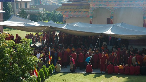 Monks, nuns, and laiety under the overflow tent, standing as the senior lamas arrive, preparing for teachings and initiation, Sakya Lamdre, Tharlam Monastery of Tibetan Buddhism, Boudha, Kathmandu, Nepal by Wonderlane