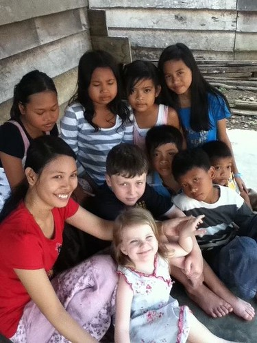 Ella, Samuel with our friend and some village kids.