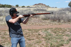 trap shooting(0.0), skeet shooting(0.0), weapon(1.0), shooting sport(1.0), shooting(1.0), clay pigeon shooting(1.0), sports(1.0), shooting range(1.0), firearm(1.0), gun(1.0),