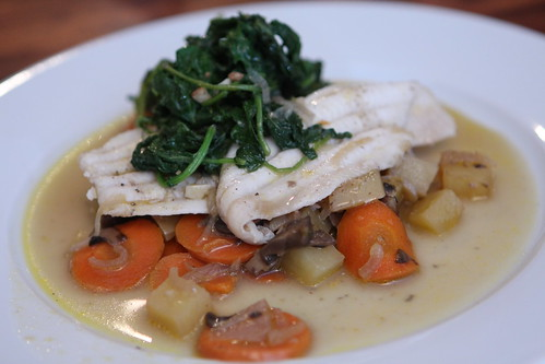 Flounder Poached in Sauvignon Blanc with Potatoes, Carrots, Garlic, Shallots, and Garlic Braised Kale