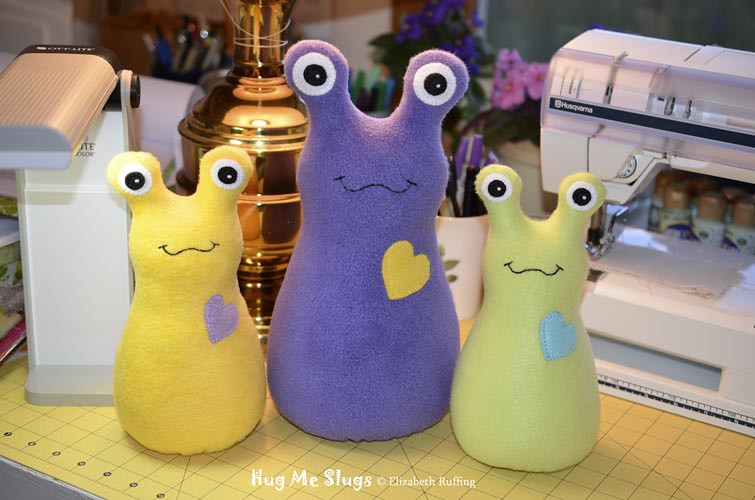 Fleece Hug Me Slug Art Toys by Elizabeth Ruffing, yellow, purple, green