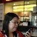 darika checks her phone over lunch    MG 3254