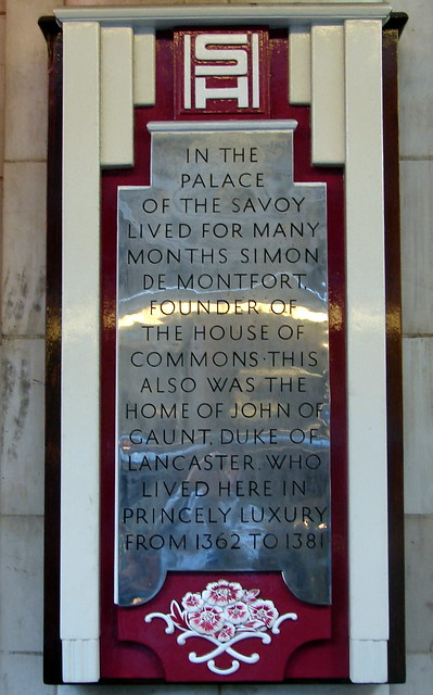 Simon de Montfort and John of Gaunt grey plaque - In the Palace of the Savoy lived for many months Simon de Montfort, founder of the House of Commons. This also was the home of John of Gaunt, Duke of Lancaster, who lived here in princely luxury from 1362 to 1381