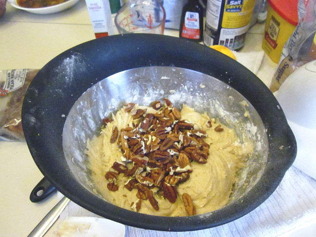 Putting in the pecans.