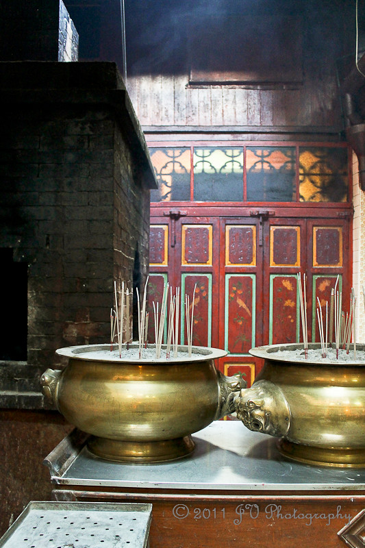 Incense offerings in brass urns