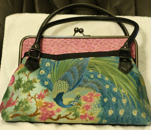 Haut Totes peacock purse