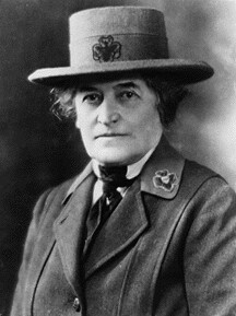Juliette Gordon Low, in black and white in a fancy Girl Scout uniform