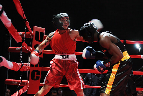Airman Daniel Silva, from Oxnard, Calif., throws a left hook during a boxing match.