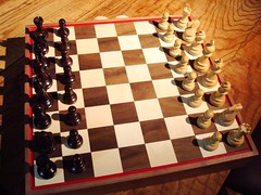 sports(0.0), english draughts(0.0), recreation(0.0), chessboard(1.0), indoor games and sports(1.0), tabletop game(1.0), games(1.0), chess(1.0), board game(1.0),