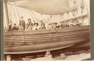 Group portrait in a beach-launched pleasure yacht, possibly the 'New Albertine', in front of the Queens Hotel, Hastings by William Smith (1910)