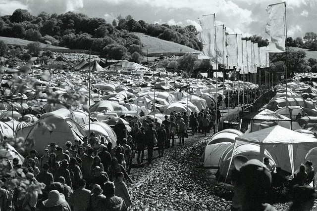 Large crowd of people at a very crowded campsite