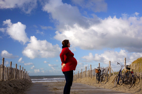 The author, 8 months pregnant. Picture taken along the North Sea in the beachside town of Scheveningen.