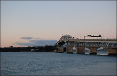 Auckland Westhaven Marina and Harbor Bridge at sunset