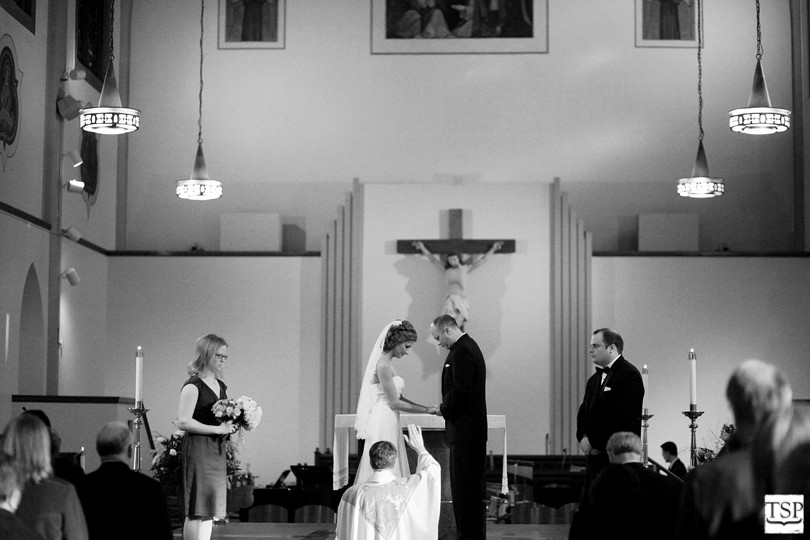 Bride and Groom Praying at Catholic Church