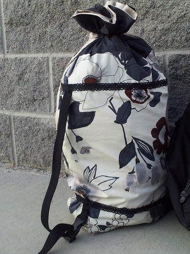 Backpack strap add on to the drawstring bag