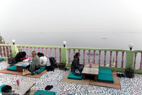 Relaxing on a rooftop, overlooking the Ganges