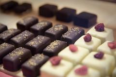 baking(0.0), petit four(0.0), baked goods(0.0), icing(0.0), purple(1.0), sweetness(1.0), bonbon(1.0), food(1.0), close-up(1.0), chocolate(1.0), praline(1.0),