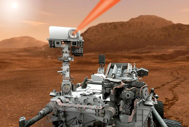Three technologies are aboard the Mars Science Laboratory mission's Curiosity rover.  Los Alamos radioisotope batteries provide heat and power as well as help drive the vehicles 10 scientific instruments.  One technology, known as ChemCam (pictured in the illustration) is mounted on the rover's mast and uses extremely powerful pulses of laser light to vaporize pinhead-sized areas of the Martian surface from as far away as 23 feet.  The tiny flashes created by these pulses will be analyzed by a spectrometer to provide scientists with crucial information about the composition of Mars surface materials.  Another LANL technology, CheMin, uses X-ray diffraction to determine the composition of samples that are collected and dropped into a funnel on the rover.  Cover story of LANL's Why magazine, November 2011: go.usa.gov/N5I  More about ChemCam from LANL's 1663 science and technology magazine:  <a href=