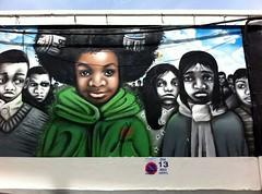 art(0.0), photomontage(0.0), album cover(0.0), street art(1.0), mural(1.0), poster(1.0),