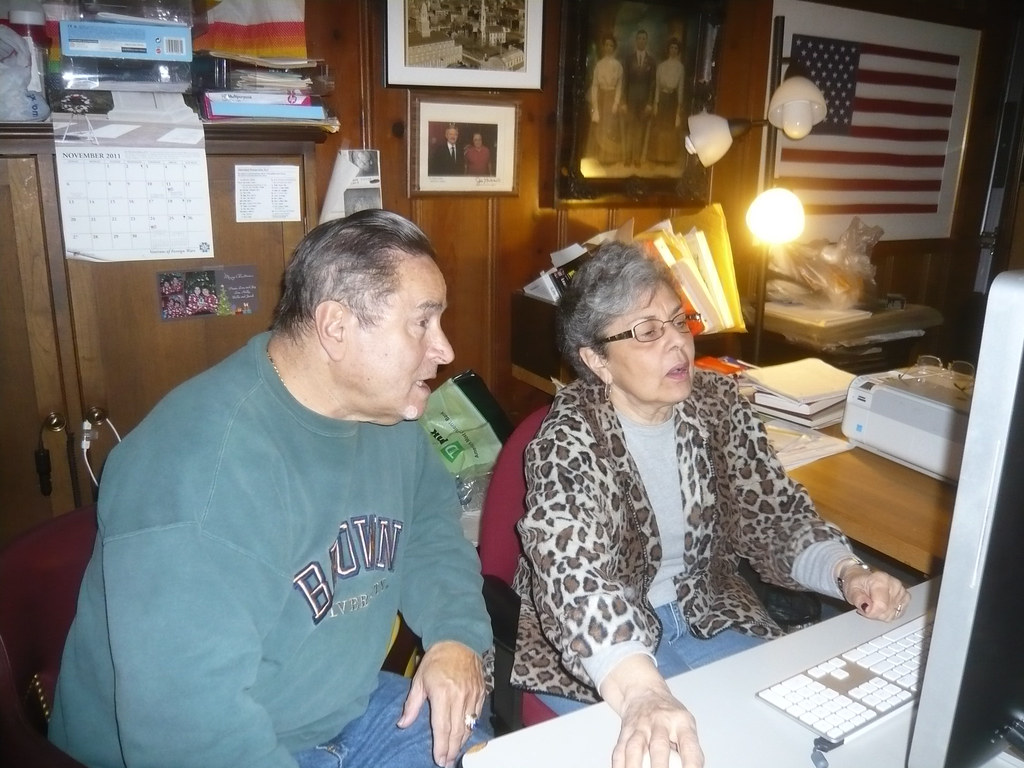 Lou Costa and Phyllis Bicho  Pacheco working on Fox Point photos. November 30. 2011.