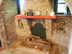 kitchen appliance(0.0), food(0.0), cuisine(0.0), hearth(0.0), masonry oven(1.0), fireplace(1.0), brickwork(1.0),