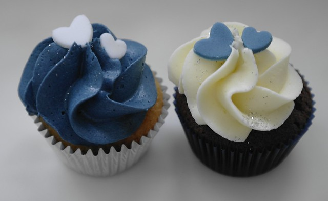 Cute little mini cupcakes in navy blue and ivory for a wedding tower