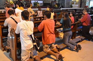 praying in Santo Niño Church in Cebu City in Philippines