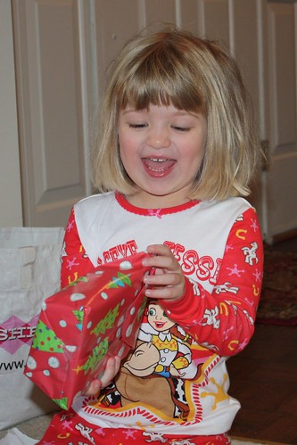 Catie opening her presents on Christmas.