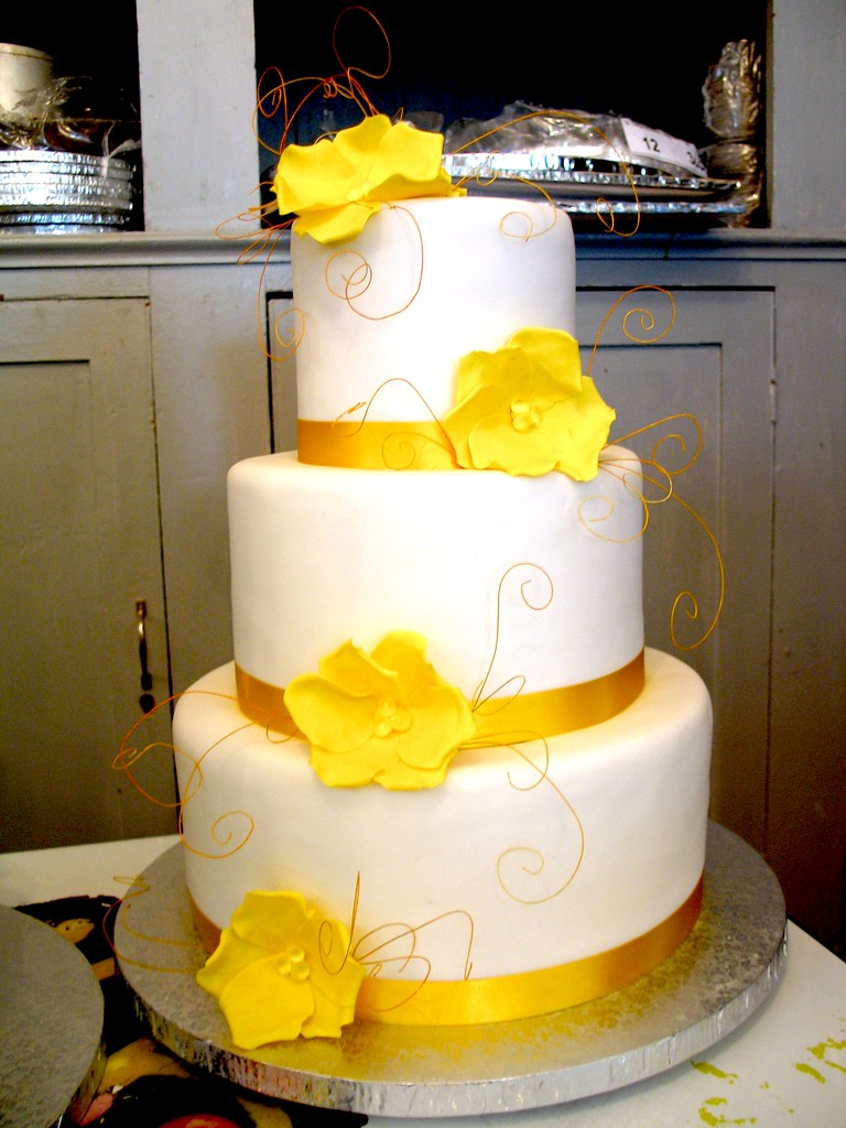 3-tier Wicked Chocolate wedding cake covered in white fondant ...