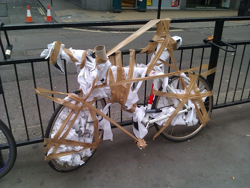 Someone's bike wrapped in toilet paper