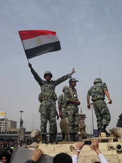 Egyptian soldier waves flag no 2. - Tahrir Square 29 January 2011.