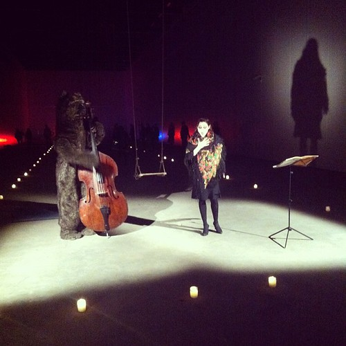 Natalia Dominguez Rangel sings and swings with a bear playing contrabass.