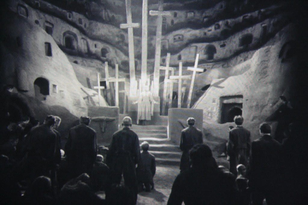 the meeting in the catacombs