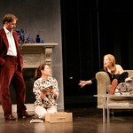 """Henry (Rufus Collins), his wife Charlotte (Meg Gibson), and their daughter Debbie (Pepper Binkley) discuss Debbie's impending tour with a performing arts group  in the Huntington Theatre Company's production of """"The Real Thing,"""" part of the 2005-2006 season. Photo by T. Charles Erickson."""