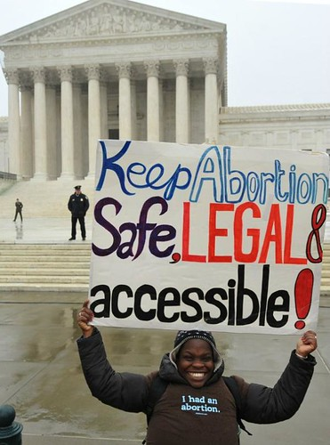 "Protester holds a sign reading ""Keep Abortion Safe, Legal & Accessible"""