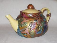 jug(0.0), pitcher(0.0), art(1.0), pottery(1.0), tableware(1.0), ceramic(1.0), teapot(1.0), porcelain(1.0),