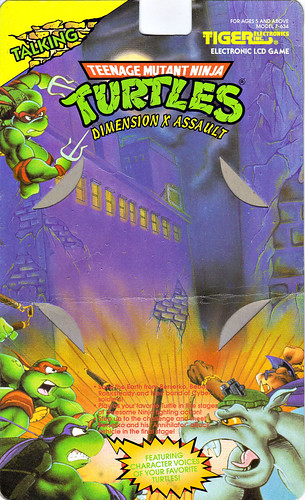 "TIGER ELECTRONICS :: ""TEENAGE MUTANT NINJA TURTLES: DIMENSION-X ASSAULT"" 'TALKING' ELECTRONIC LCD GAME ..card backer i (( 1995 ))"