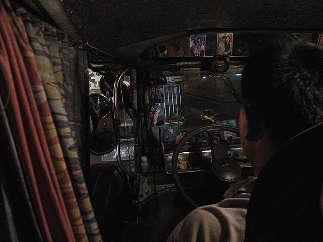 buendia jeepney driver with family photos