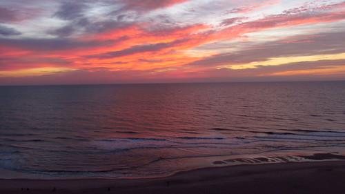 ocean morning sky sun beach clouds sunrise dawn md surf day cloudy maryland oceancity oc paintedsky ocmd reddawn oceancitymaryland