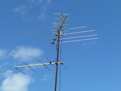 machine(0.0), electronic device(0.0), overhead power line(0.0), mast(0.0), wind(0.0), television antenna(1.0), electricity(1.0), antenna(1.0),
