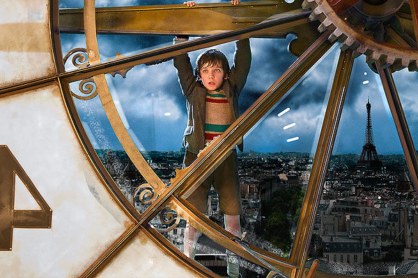 Asa Butterfield gets into some tight spots in HUGO.