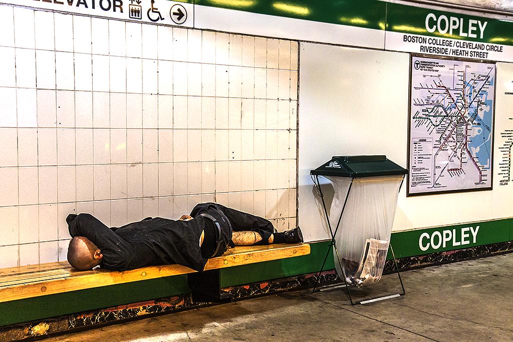 Man-sleeping-at-Copley-Station--Boston