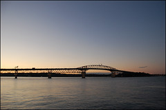 Auckland Harbor Bridge from Westhaven Marina at sunset