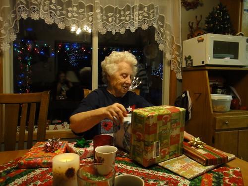 Grandma opening her presents.