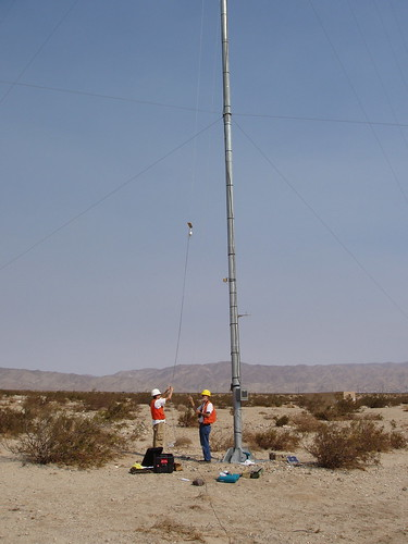 Forest Service staff installing bat echolocation detector on meteorological tower Photo by Ted Weller.