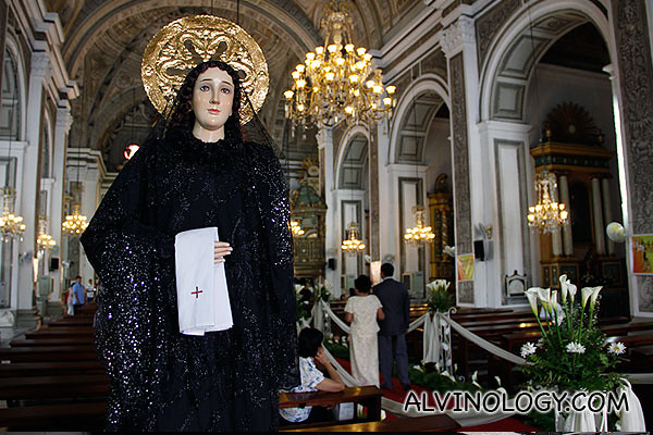 A holy female figurine on the left