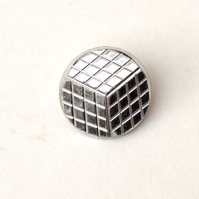 Vintage silver plastic disco button – 18mm