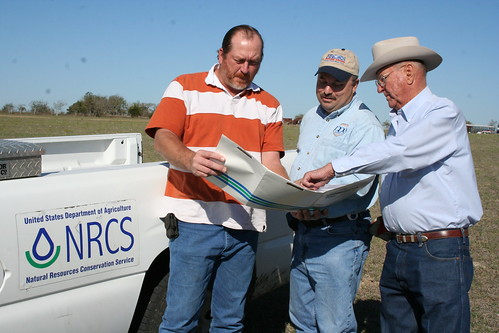 NRCS Civil Engineering Technician, Minzenmeyer and Fayette County SWCD technician, Milton Koenning visit with David Brooks about his conservation plan for continuing improvements on the ranch.