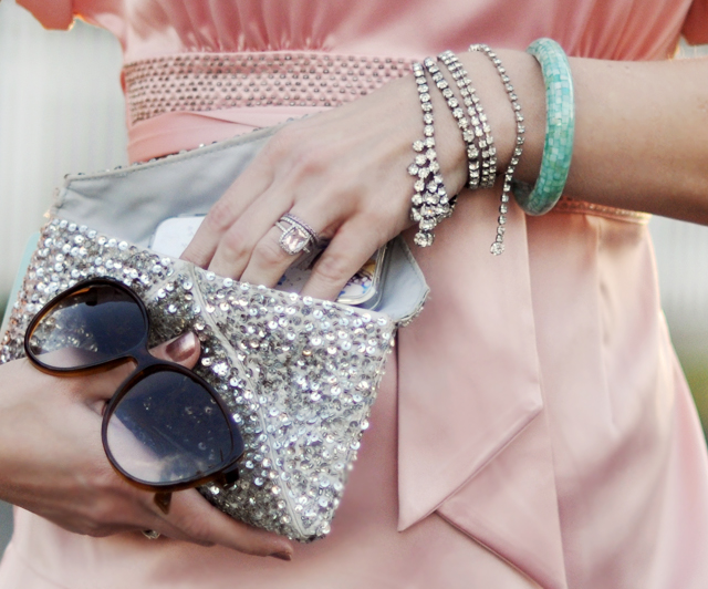 pink satin blouse- silver sequin clutch-rings-bracelets
