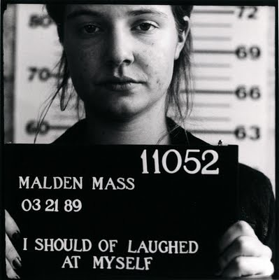 Black and white mugshot-style photo of a young white woman. Text reads I should of laughed at myself